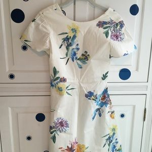 A floral and white Zara dress.